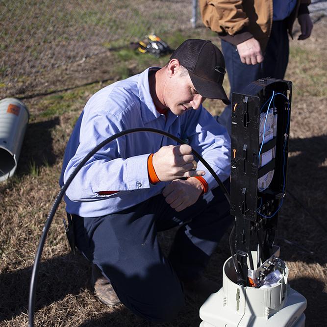 NATCO Technician Wade Burroughs installs new fiber services