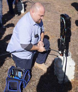 NATCO Technician Installs Fiber