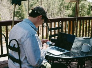 Man Works on Laptop Outdoors